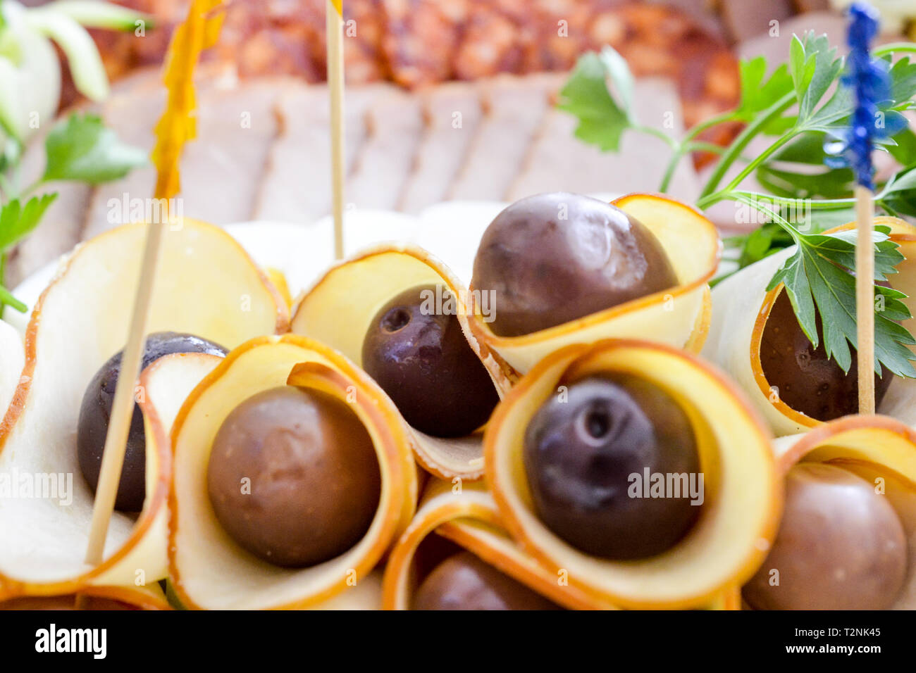 wll decorated party catering food,salami and olives - Stock Image