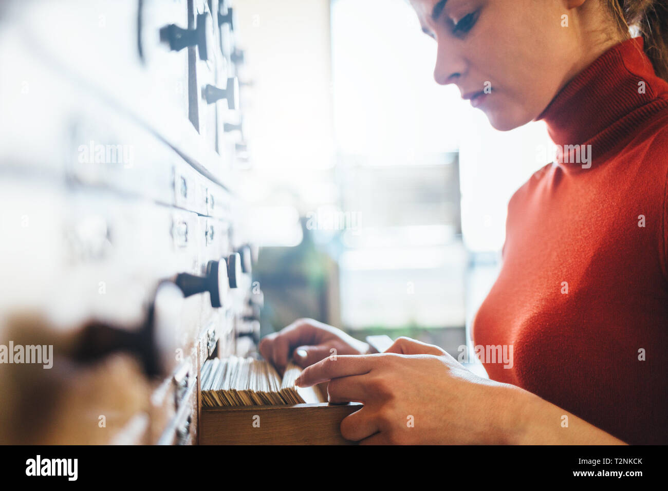Woman opens database drawer.  Archive, database, library concept - Stock Image