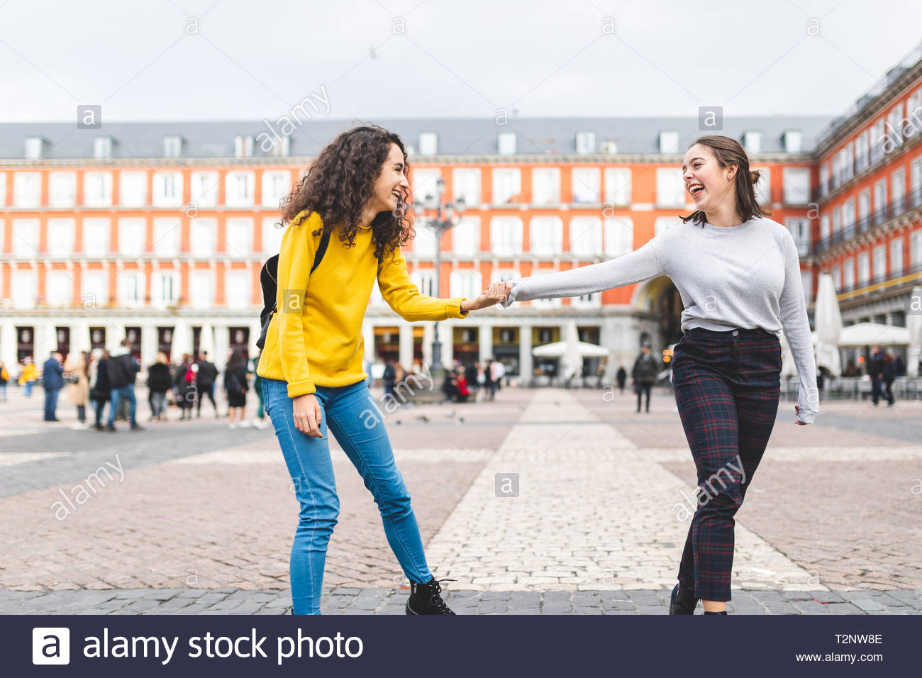 Girlfriends exploring city, Madrid, Spain - Stock Image