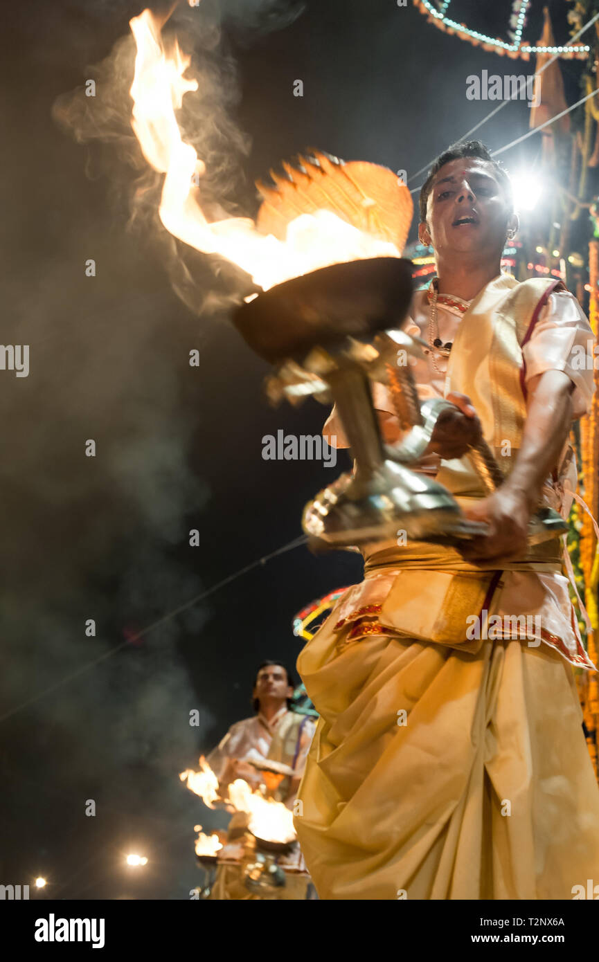 Hindu priests perform rituals during the evening Ganga Seva Nidhi, a religious Hindu ceremony that takes place twice every day. - Stock Image