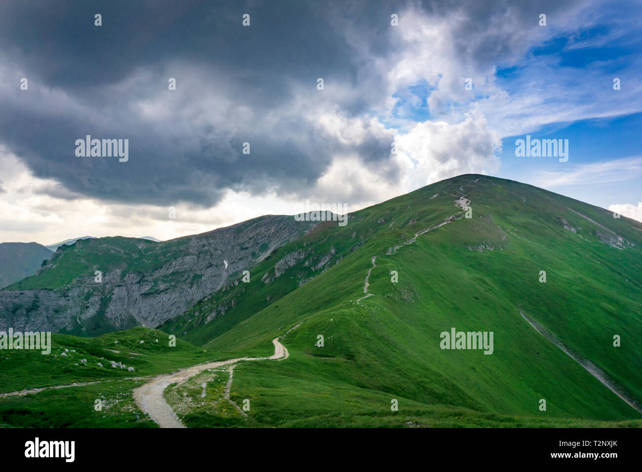 Whirling clouds over the peaks of the Tatra Mountains in June. Area of Czerwone Wierchy. - Stock Image
