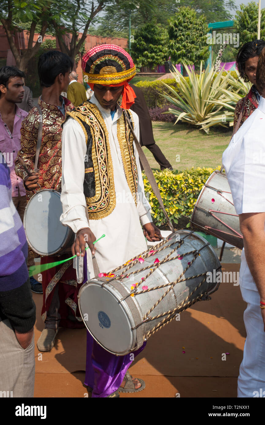 Traditional Indian dhol drummers, drumming during wedding celebrations. - Stock Image