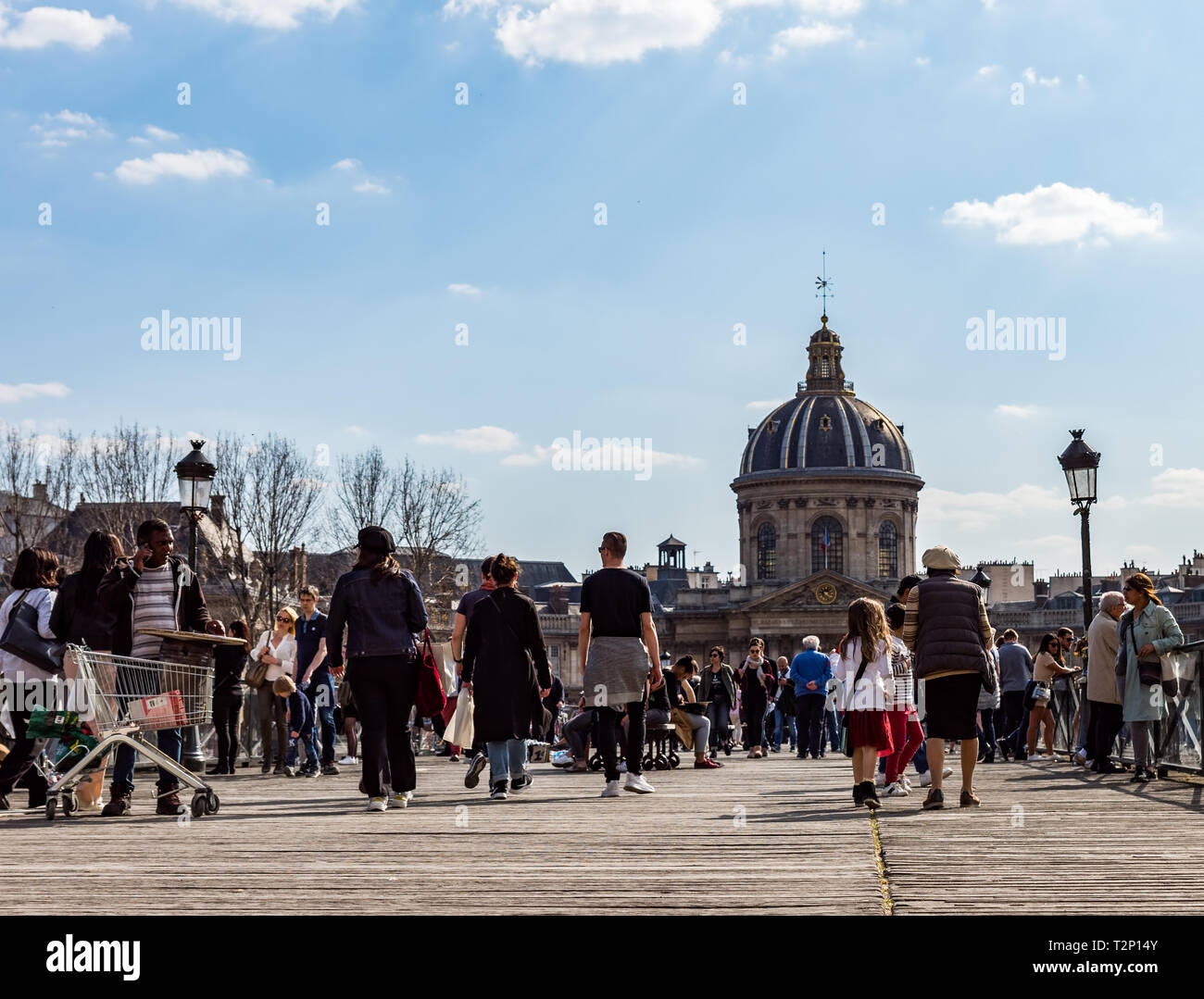 People walking on Pont des Arts bridge on the Seine river - Paris - Stock Image
