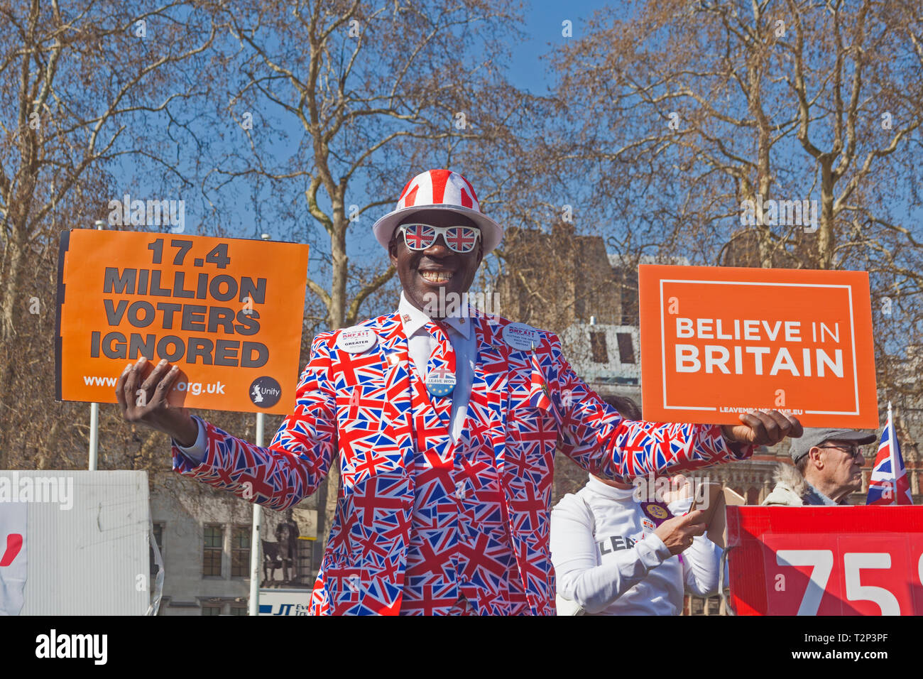 London, Westminster.  A colourfully-dressed activist in Parliament Square on March 29th 2019, the original Brexit 'leaving day.' - Stock Image