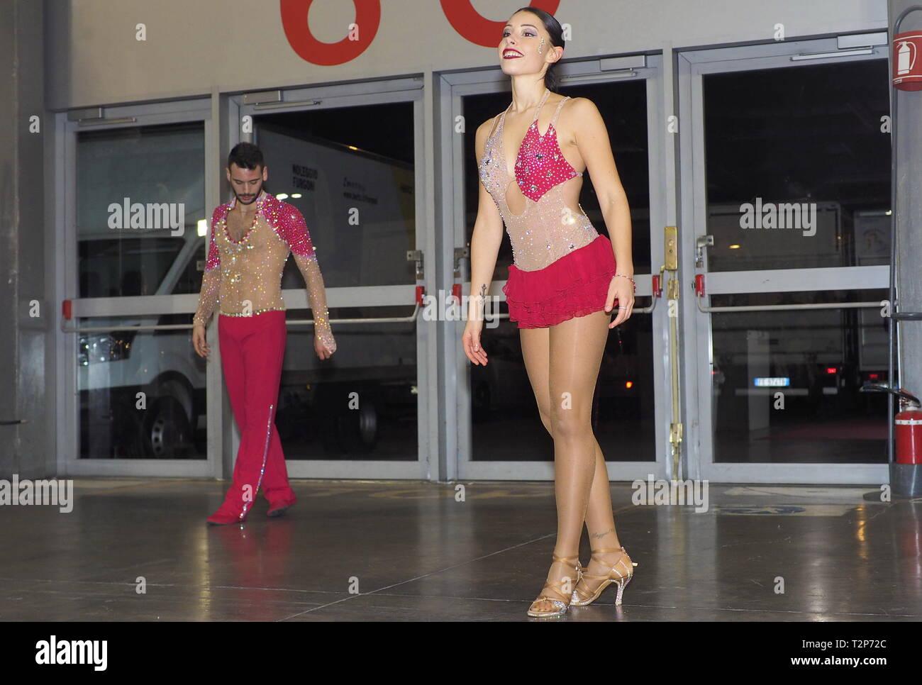Rho, Italy 1 December 2019: Romanania dancers show during artisans fair. - Stock Image