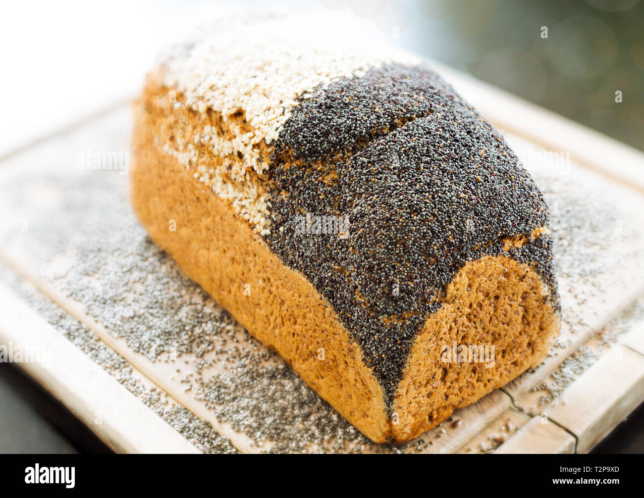 Bread with a crust of different seeds - Stock Image