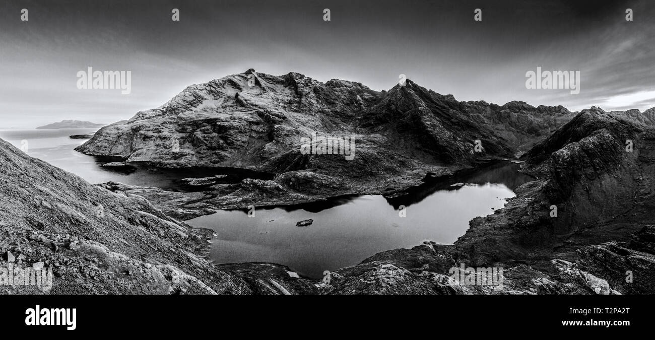 A black and white photo of Skye's Cullin range on Scotlands Highlands - Stock Image