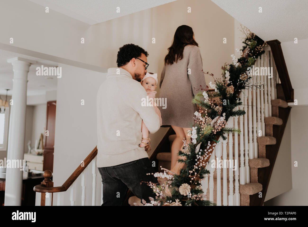 Family going upstairs to bed - Stock Image