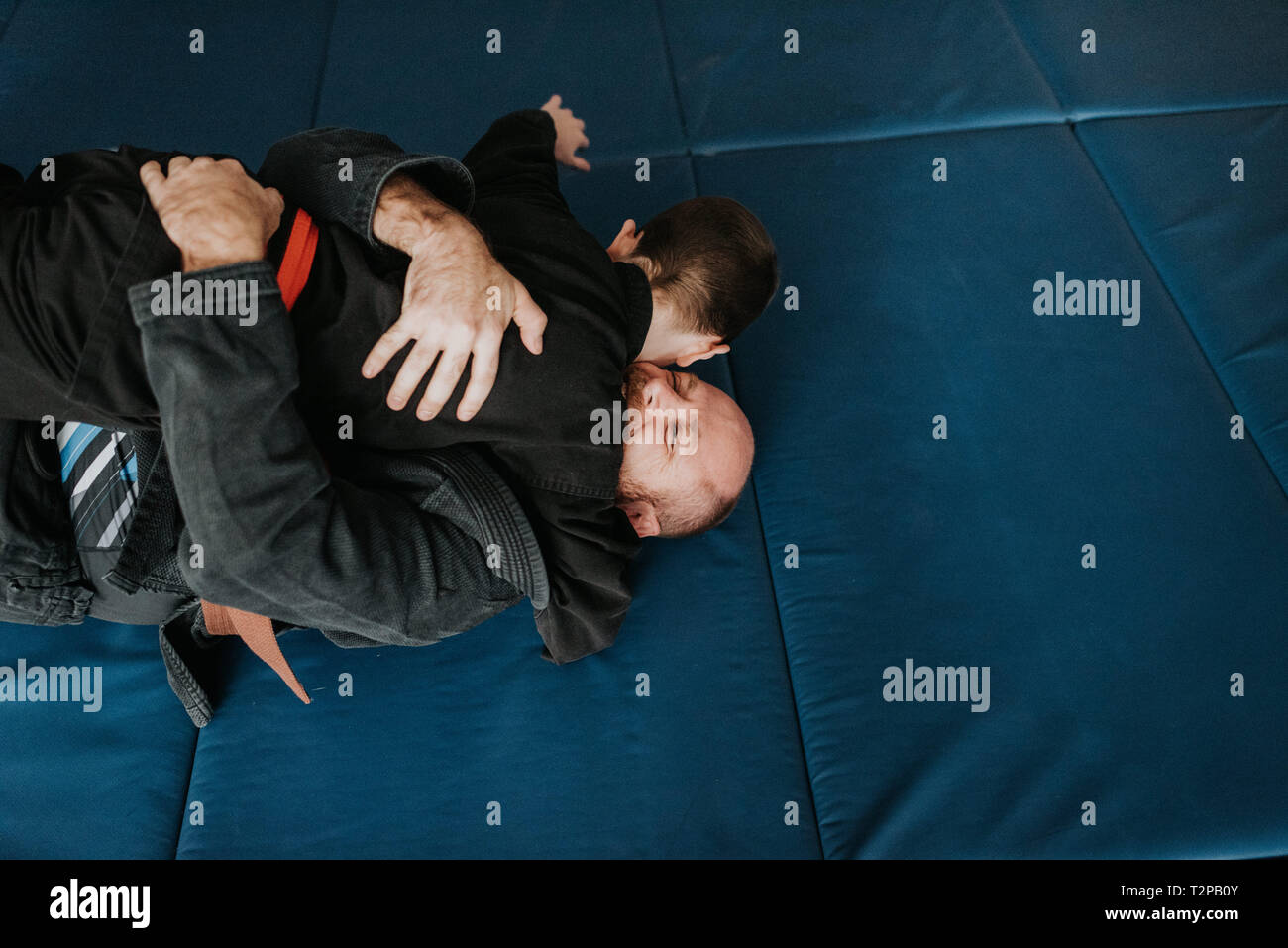 Coach and student wrestling in studio - Stock Image