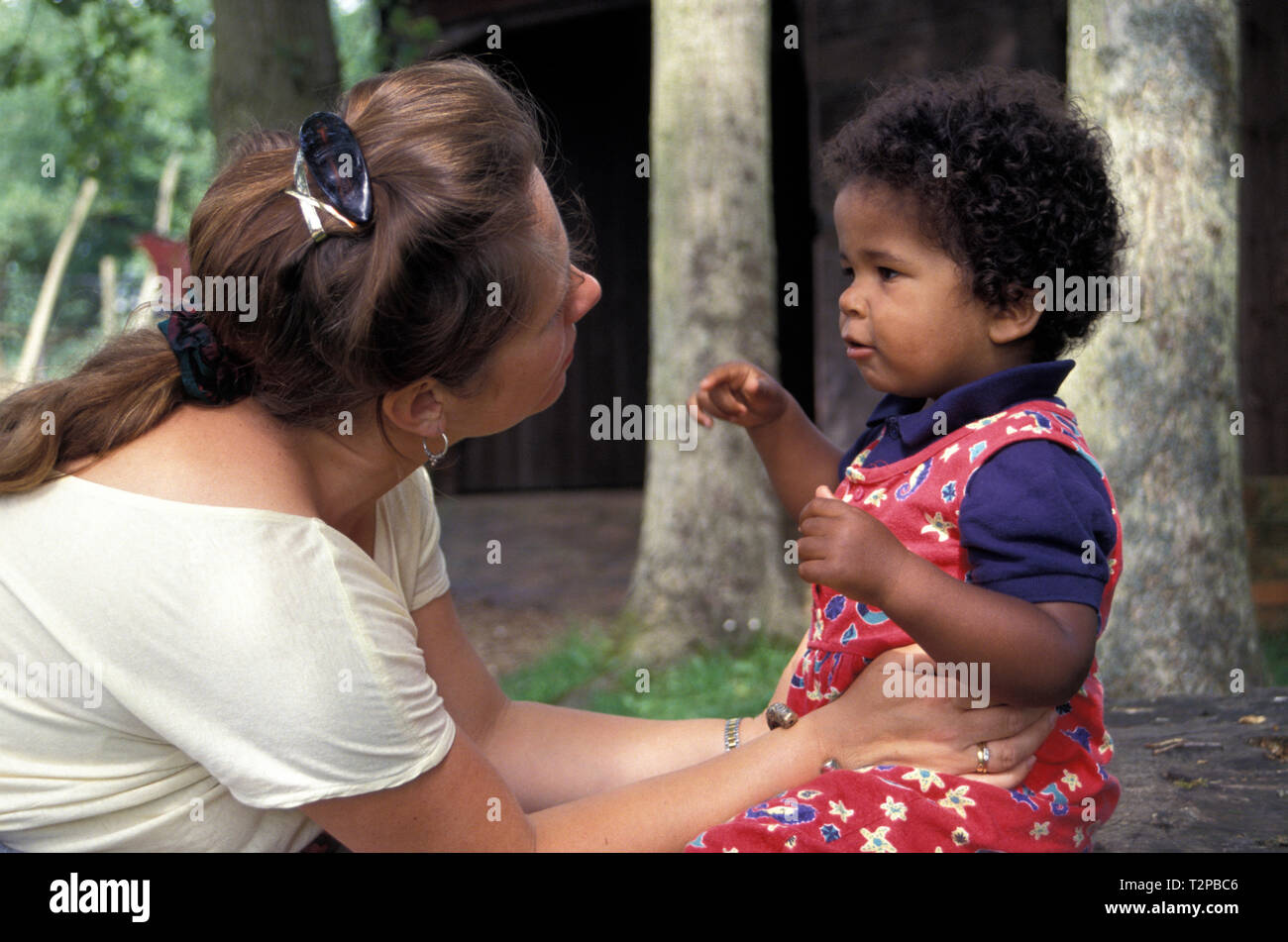 mother telling off her young son Stock Photo