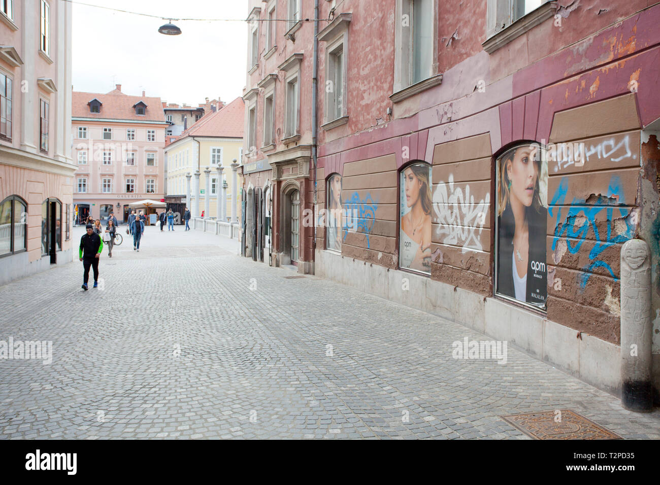 Street posters of women among graffiti - Stock Image