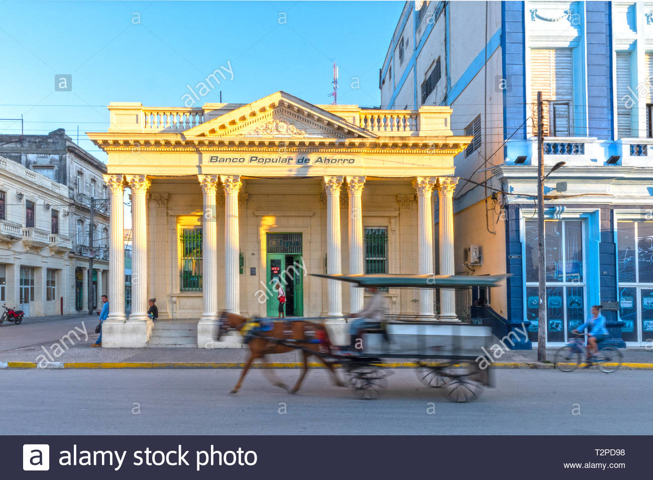 Old bank building occupied by the 'Banco Popular de Ahorro'. The area is a National Monument and a tourist attraction. Cuban lifestyle in the morning. - Stock Image