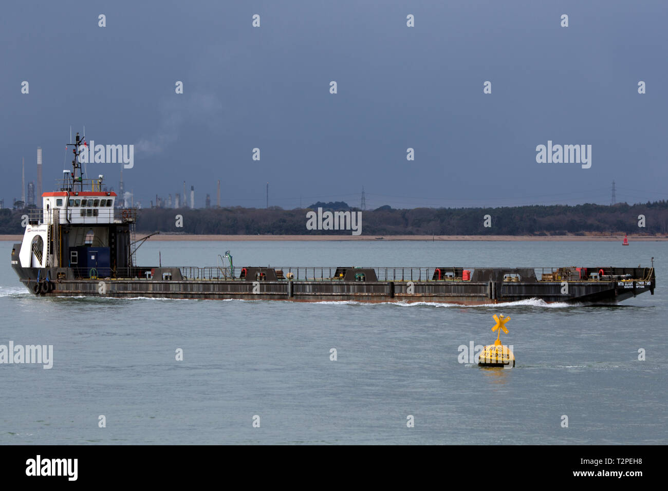 Blade,Runner,Two,2,specialist,ship,for,carrying,wind,farm,blades,offshore,wind,farms,shipping,Vestas,The Solent,Southampton,Isle of Wight,England,UK, - Stock Image