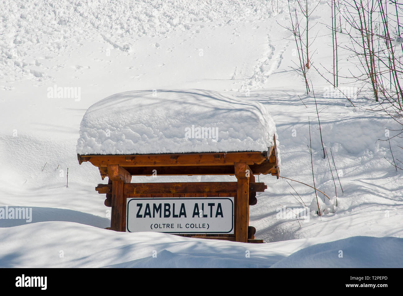 road sign covered by heavy snowfall - Stock Image