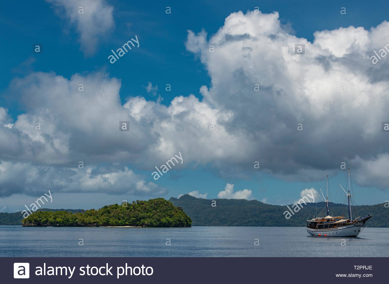 Sailboat anchored at small island in Raja Ampat, Sorong, Nusa Tenggara Barat, Indonesia - Stock Image