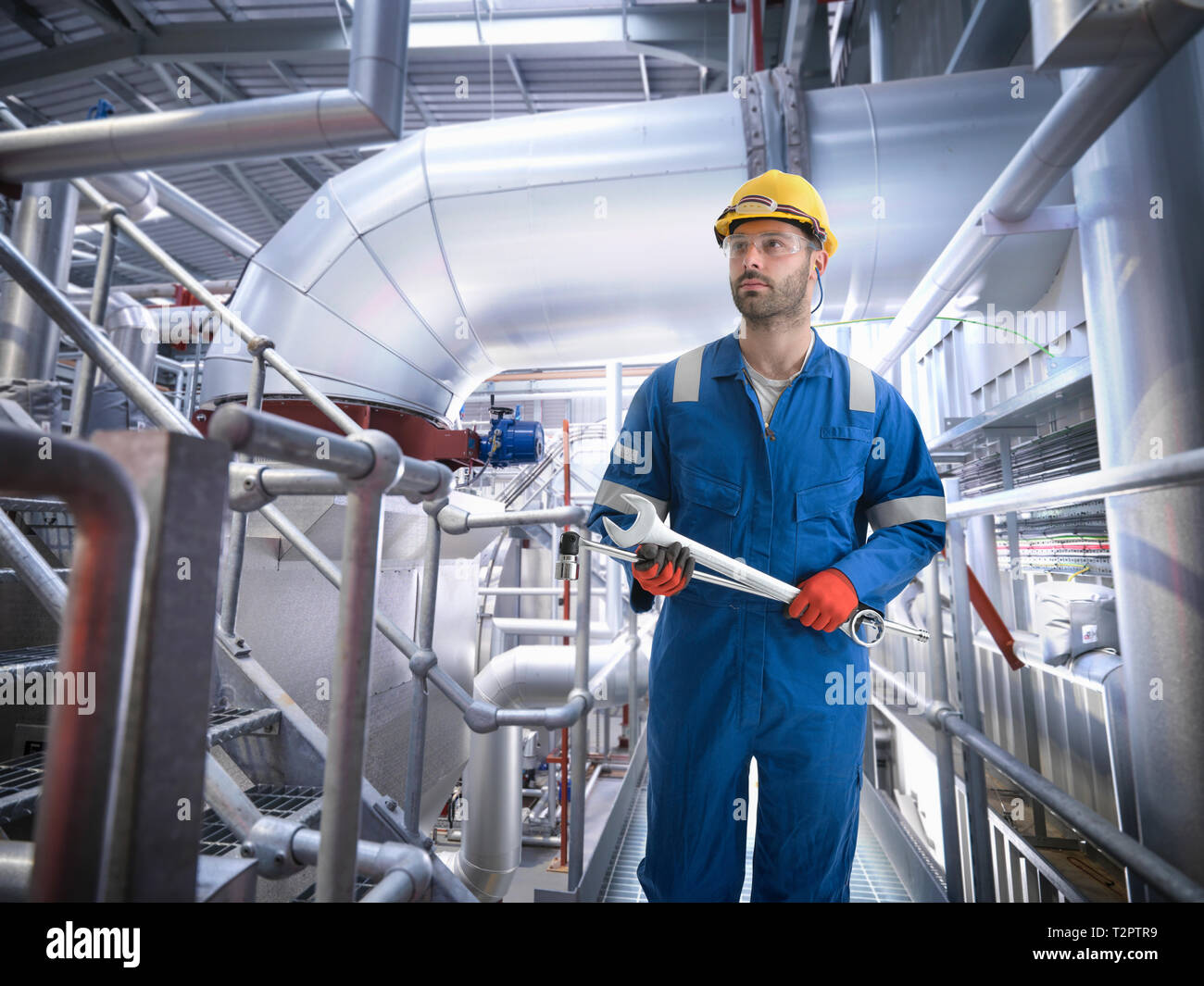 Composite image of engineer in gas power station - Stock Image