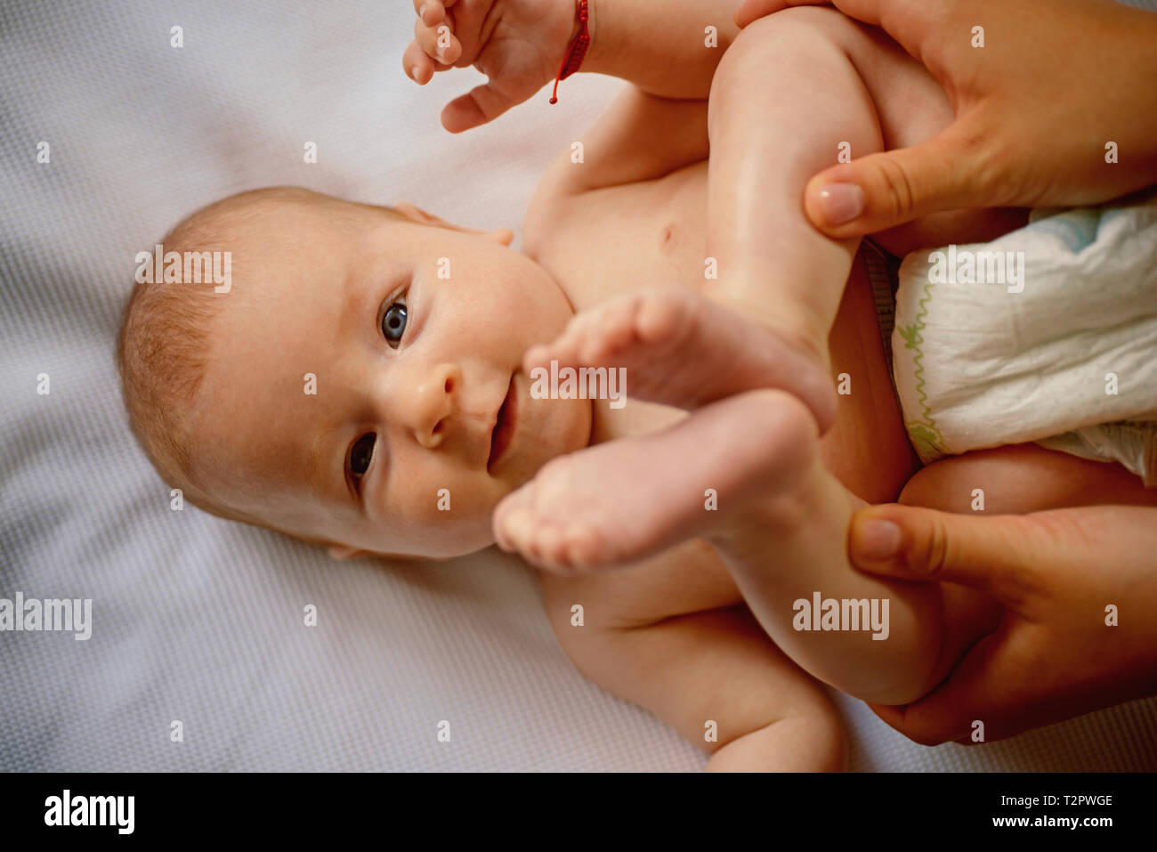 Newborn baby. Family care of newborn baby. Family love and care. Infant developmental psychology. Psychology of babies. Insight into infant minds. Car - Stock Image