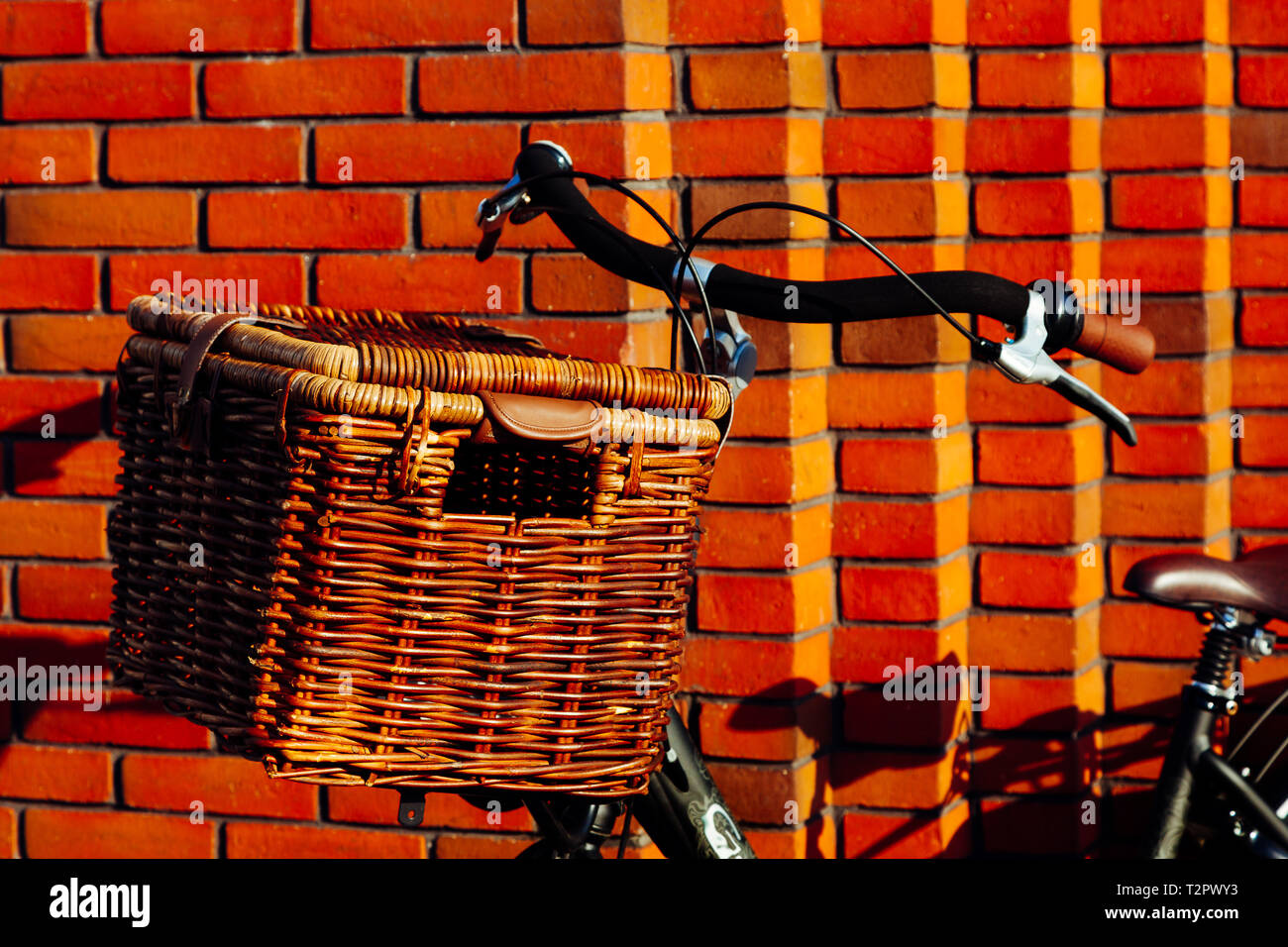 f169eea7e4d Large vintage wicker brown basket on a bicycle. Old dutch bike with a  wooden basket