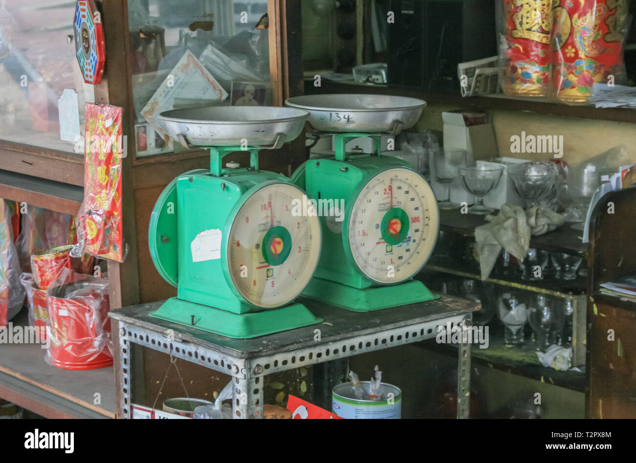 Two weighing scales in a Chinese shophouse, Johor Bahru, Malaysia - Stock Image