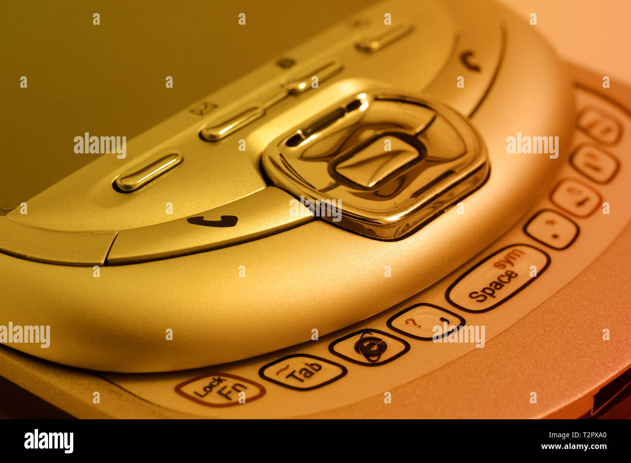PDA. Old type mobile phone. Picture in orange tint - Stock Image