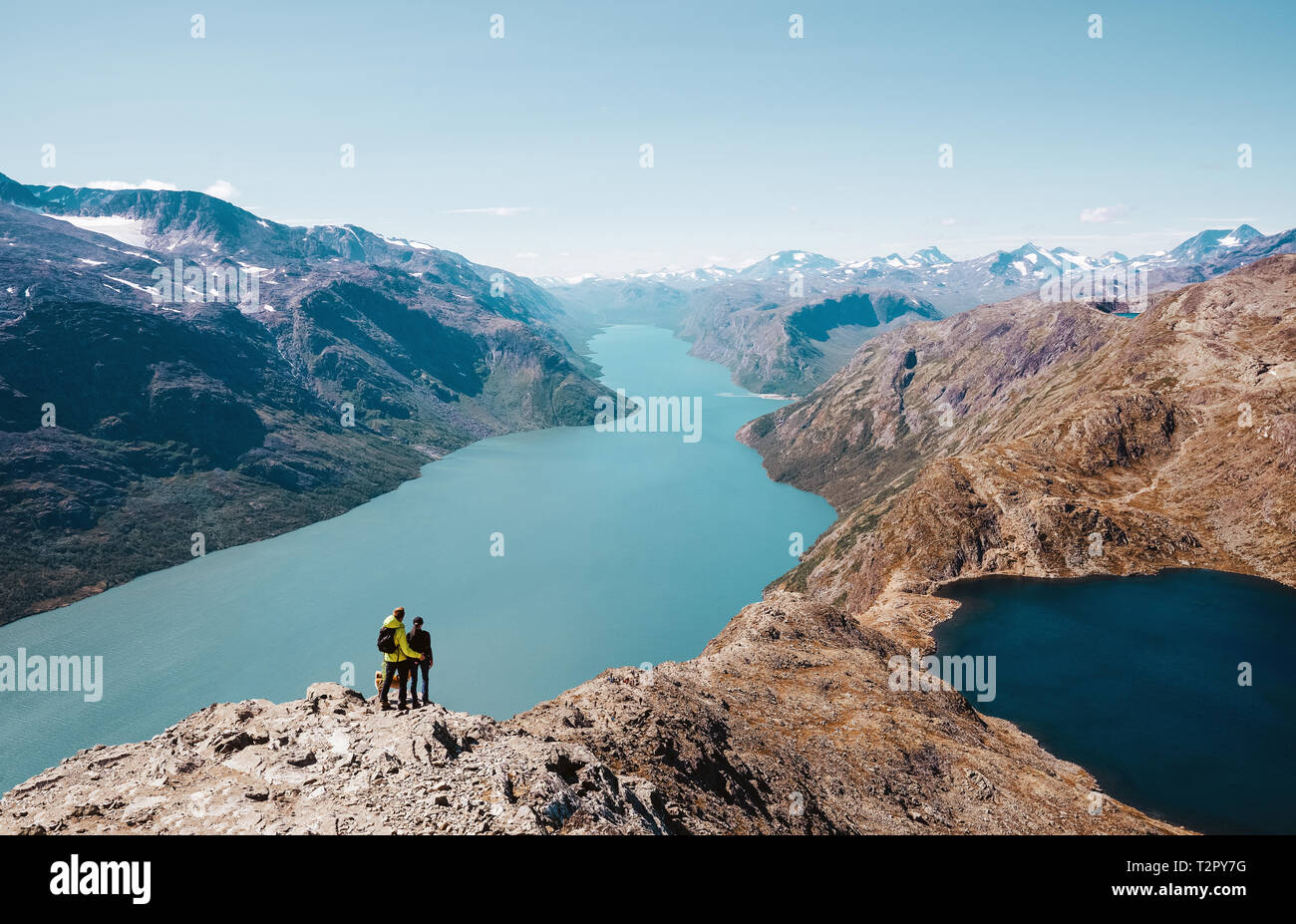 Couple enjoy the view at the norwegian landscape - Stock Image