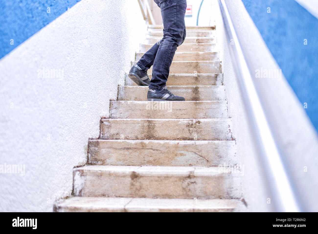 Close up of male legs moving up the stairs Stock Photo