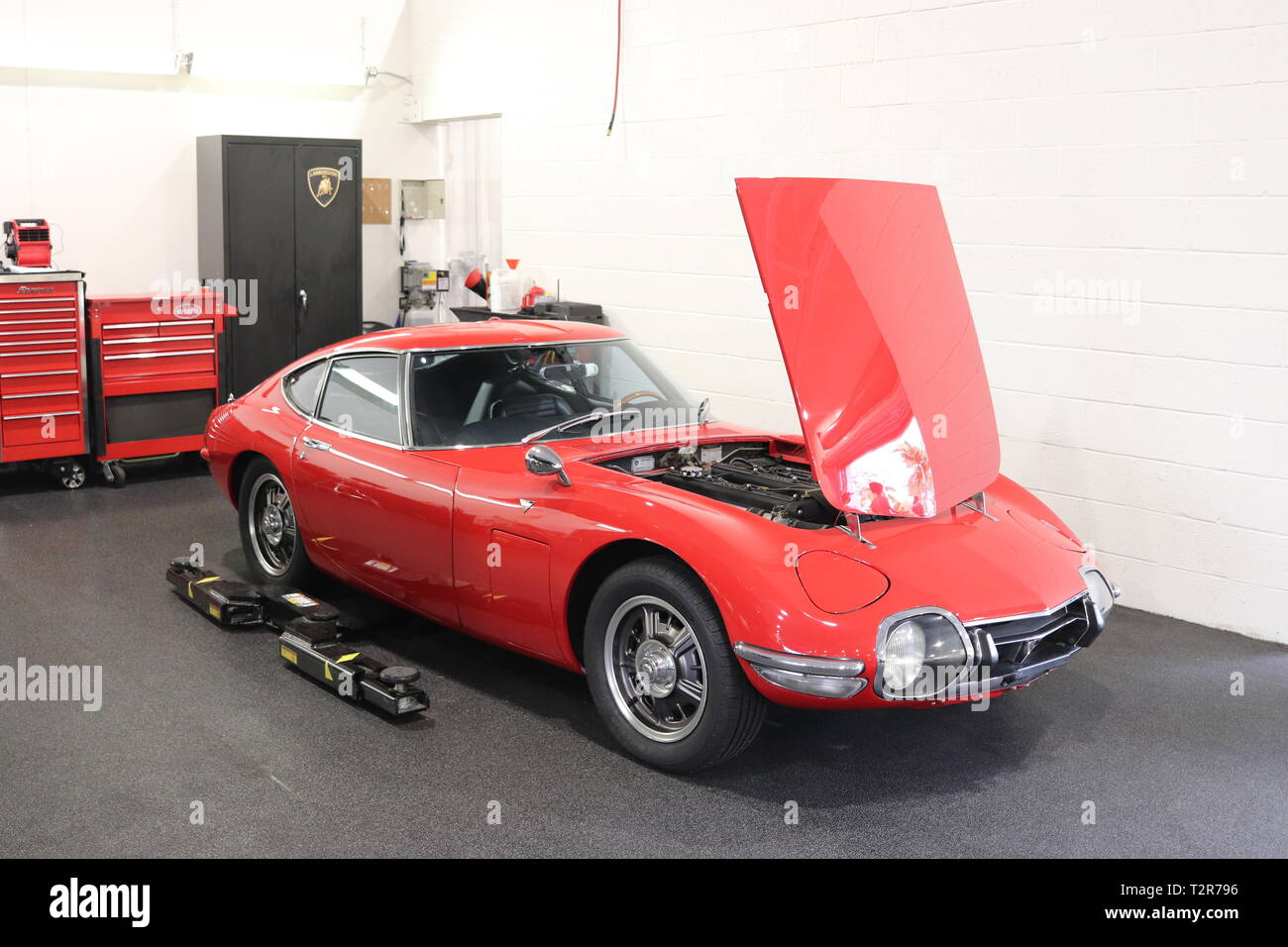 Classic Toyota 2000GT on the shop floor. Taken at a local car show near Fort Lauderdale, Florida, USA. Classic car lovers will recognize this icon. Stock Photo