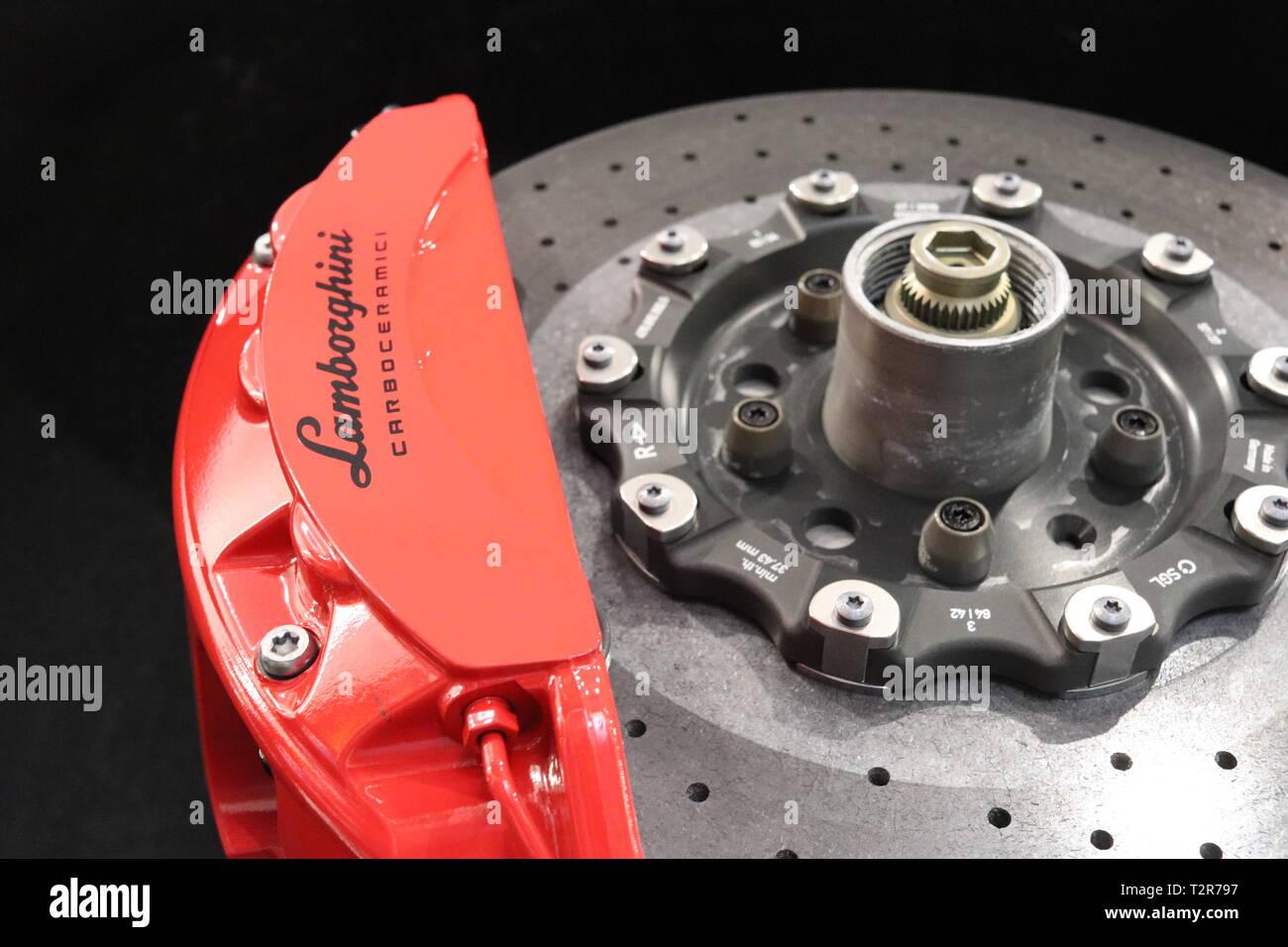Closeup (macro) of brake rotor and Caliper of Lamborghini Supercar