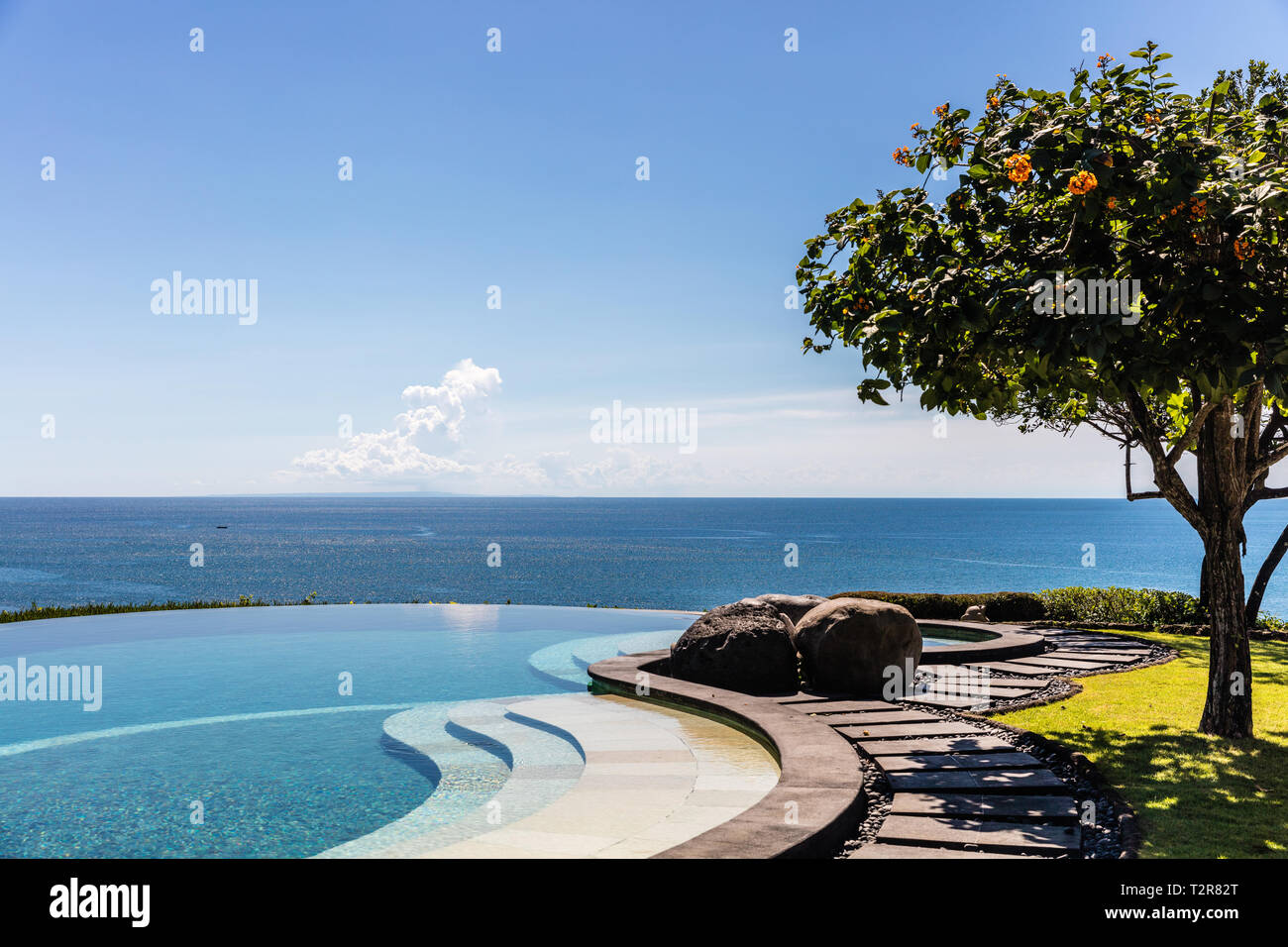 Infinity pool on the cliff edge with the view of the ocean. - Stock Image