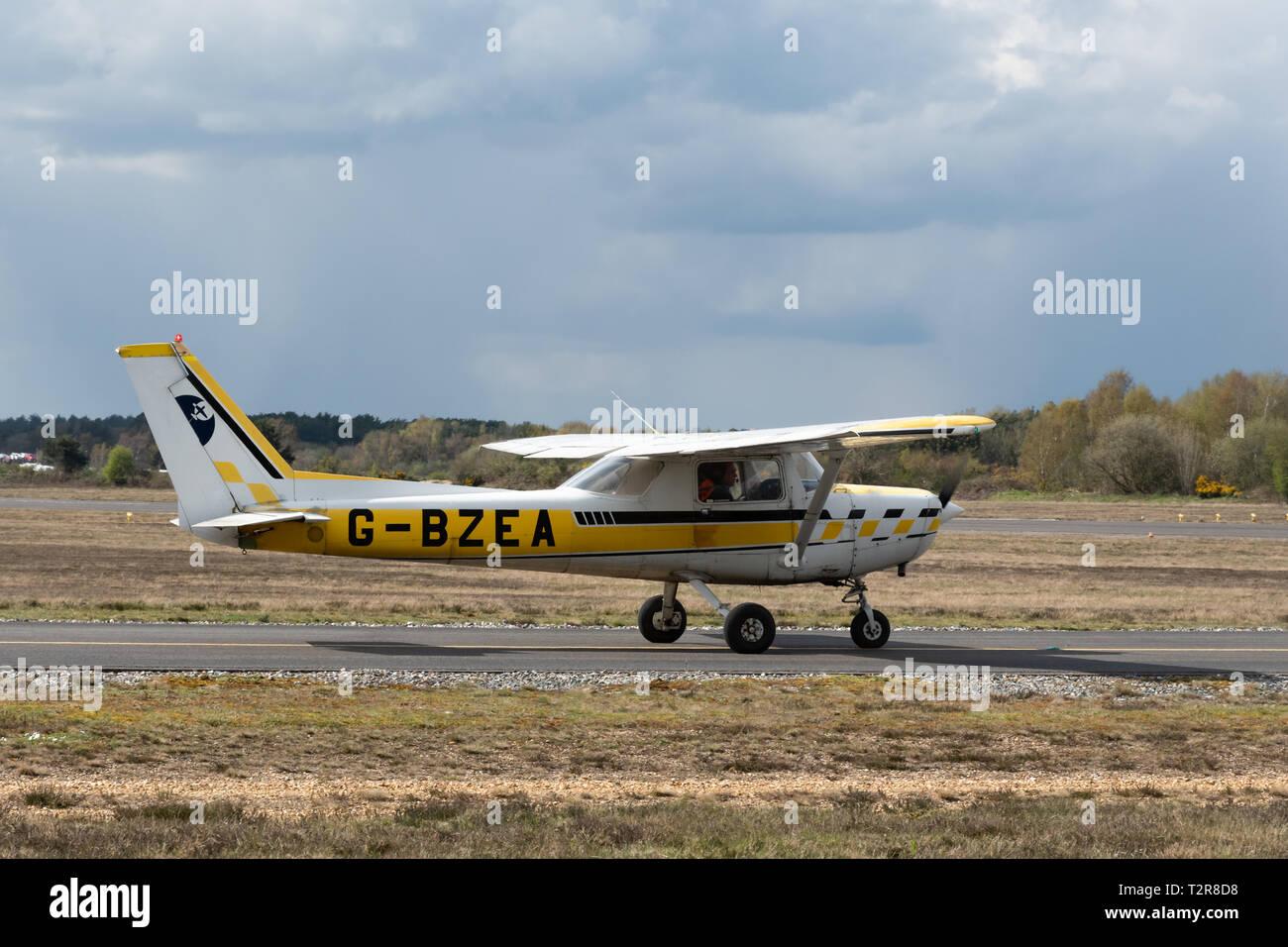 Cessna A152 Aerobat G-BZEA, a single-engine two-seat high-wing aerobatic-capable monoplane or airplane preparing to take off at Blackbushe Airport, UK - Stock Image