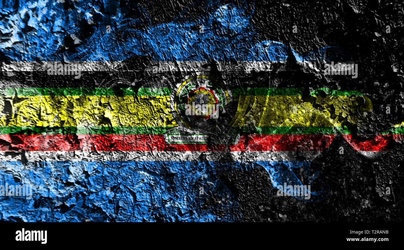 East African Community smoky mystical flag on the old dirty wall background Stock Photo