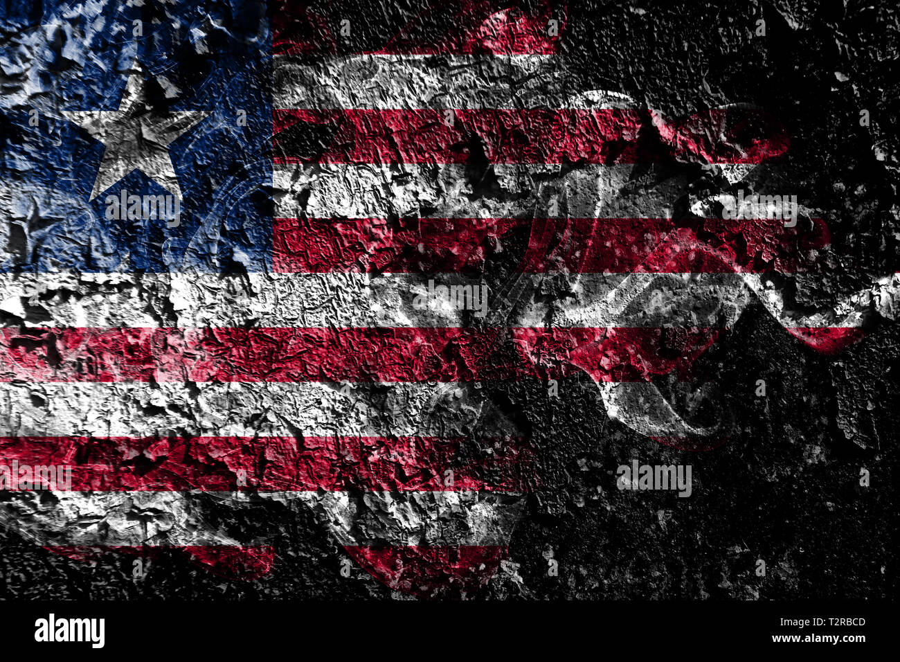 Liberia smoky mystical flag on the old dirty wall background - Stock Image