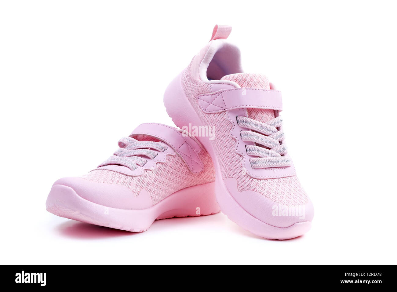 Pair of unbranded pink color sport or running shoes on a white background Stock Photo