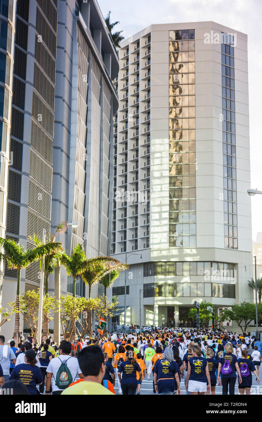 Miami Florida Bayfront Park Mercedes-Benz Miami Corporate Run community charity event runners coworkers co-workers man woman run - Stock Image