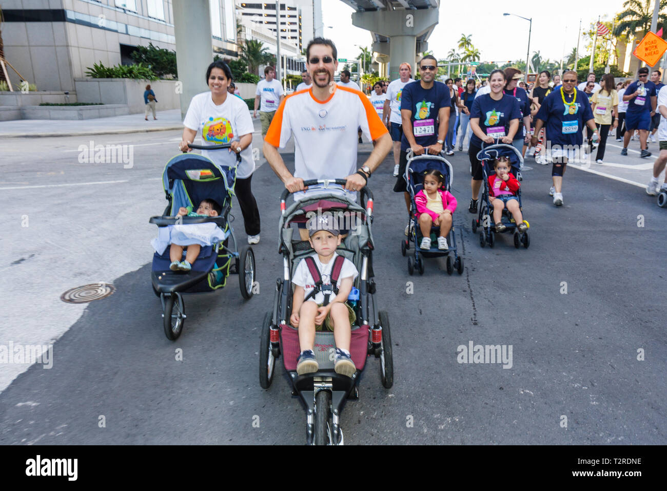 Miami Florida Bayfront Park Mercedes-Benz Miami Corporate Run community charity event runners coworkers co-workers walkers Hispa - Stock Image