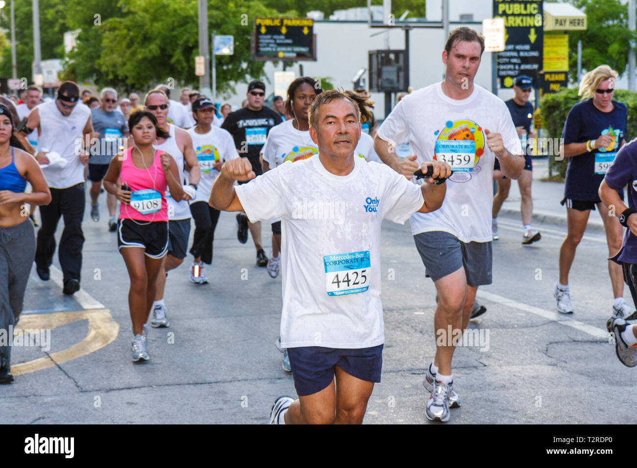 Miami Florida Bayfront Park Mercedes-Benz Miami Corporate Run community charity event runners coworkers co-workers man woman swe - Stock Image