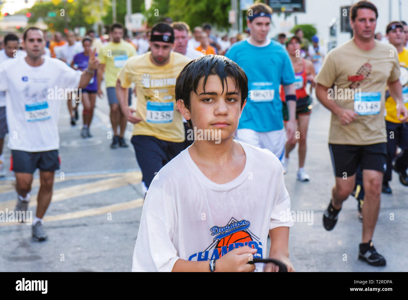 Miami Florida Bayfront Park Mercedes-Benz Miami Corporate Run community charity event runners coworkers co-workers boy teen dren - Stock Image