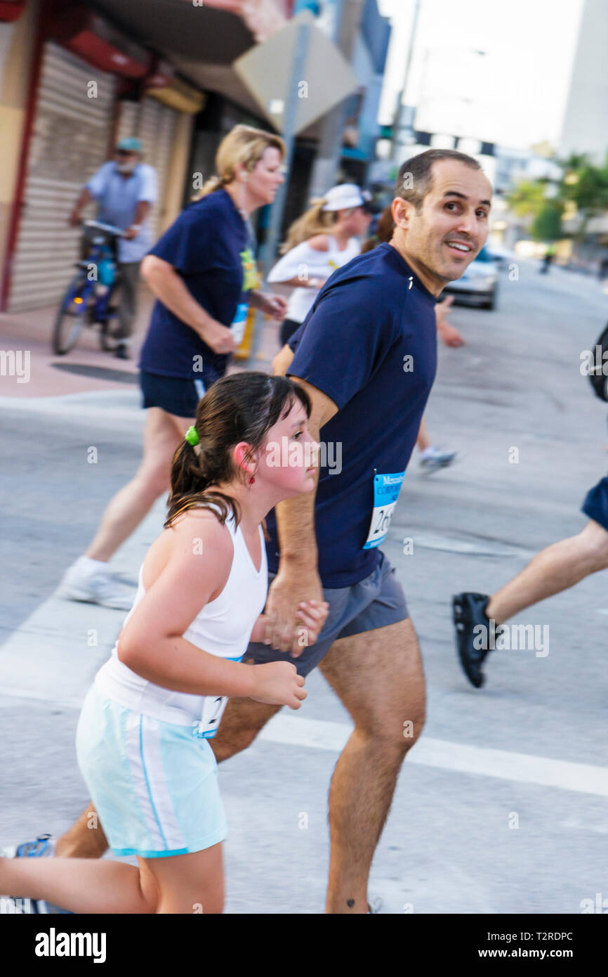 Miami Florida Bayfront Park Mercedes-Benz Miami Corporate Run community charity event runners coworkers co-workers Hispanic man - Stock Image