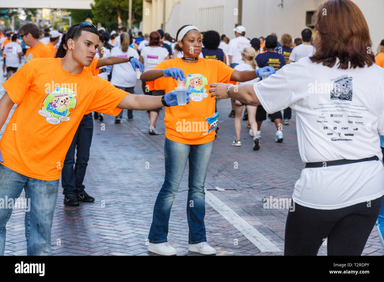 Miami Florida Bayfront Park Mercedes-Benz Miami Corporate Run community charity event runners walkers coworkers co-workers water - Stock Image