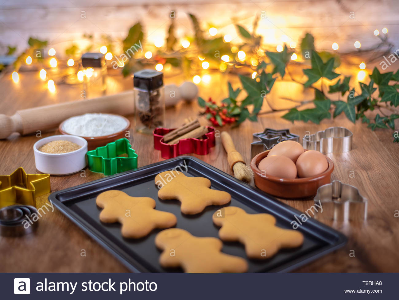 Cooking Gingerbread men at Christmas Stock Photo