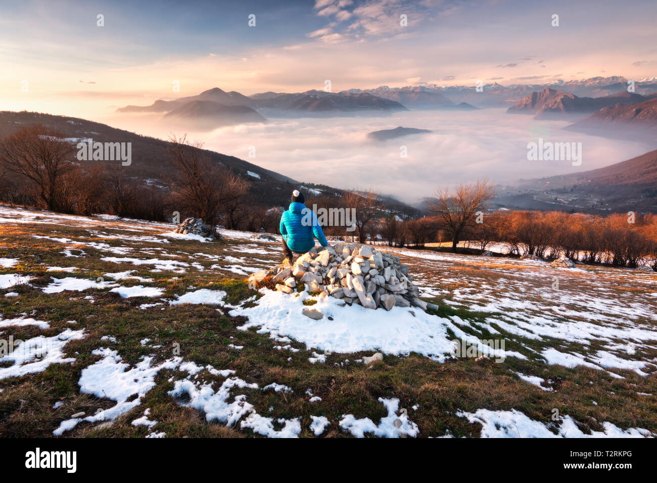 Admiring sunset over Iseo lake in Lombardy district, Brescia province, Italy, Europe - Stock Image
