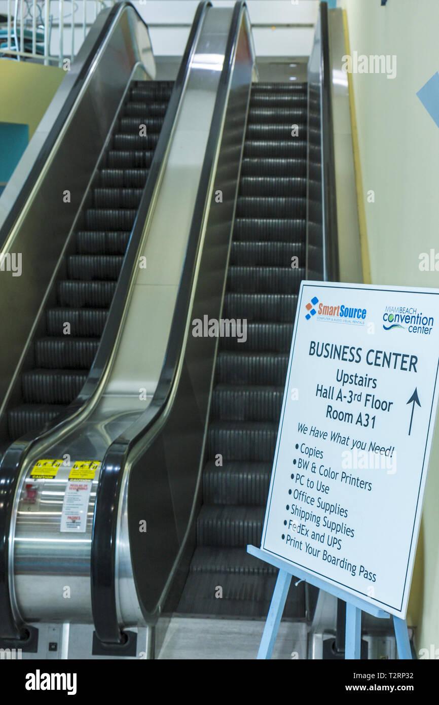 Miami Beach Miami Florida Beach Convention Center centre escalator sign direction information business center - Stock Image