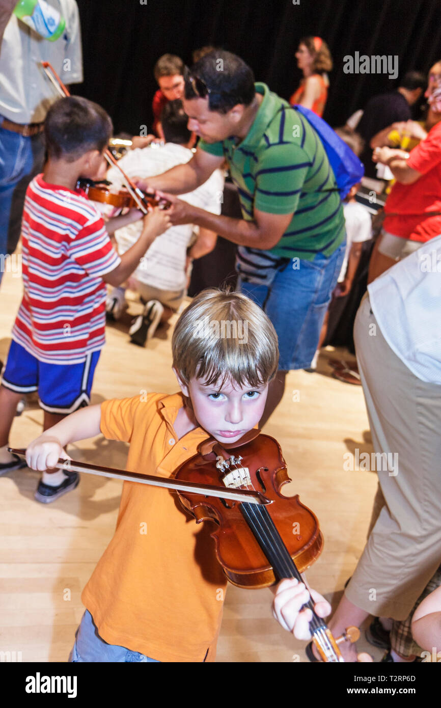 Miami Florida Adrienne Arsht Performing Arts Center centre Family Fest Instrument Discovery music hands on art education boy chi - Stock Image