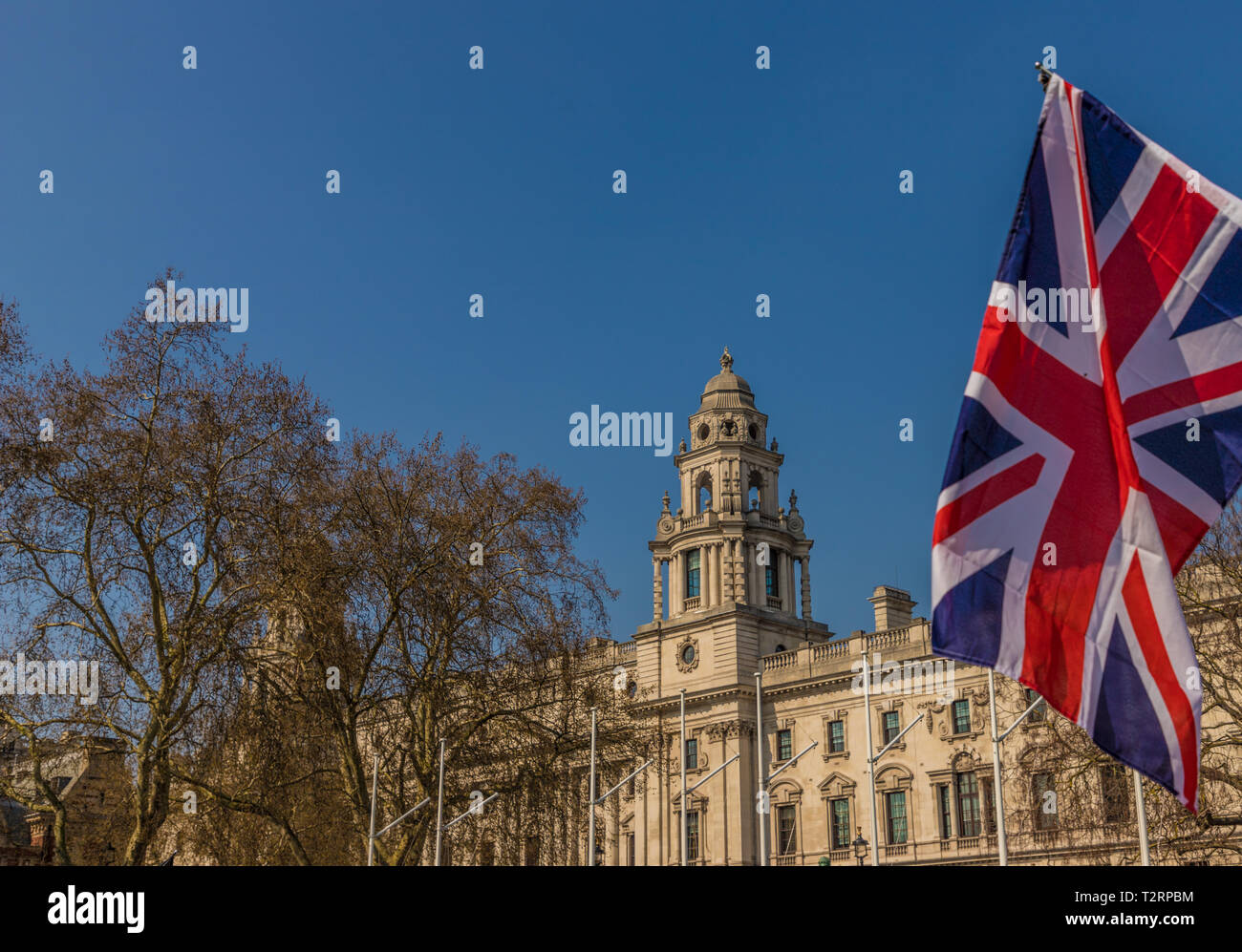 March 29 2019. London. Union flags flying by parliament in parliament square London - Stock Image