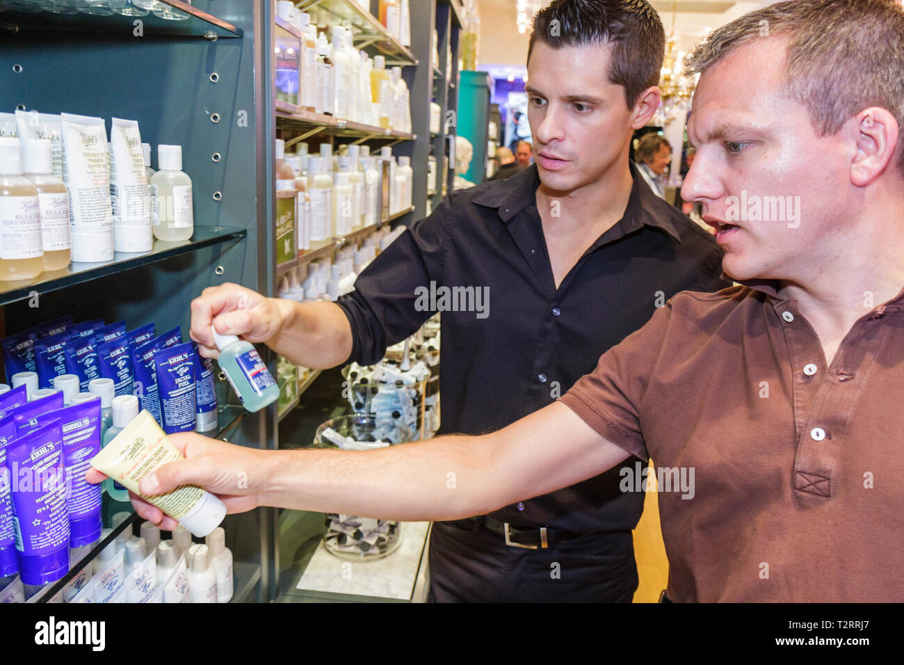 Miami Beach Florida Lincoln Road pedestrian mall shopping Kiehl's Since 1851 Gay Pride Shopping Event bottles packaging apotheca - Stock Image