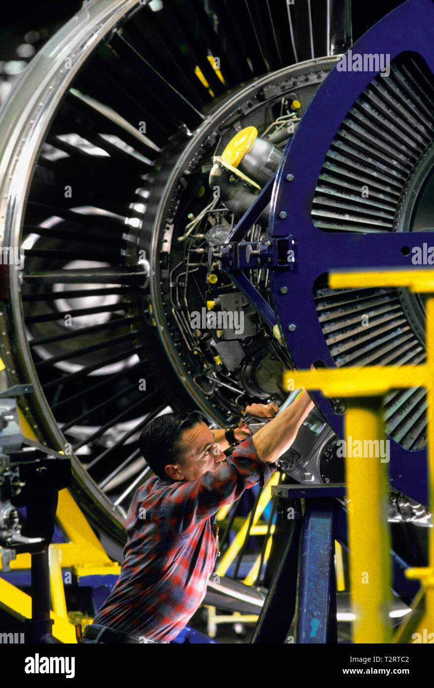 Skilled workman installing a part in a jet engine at the Pratt and Whitney factory in Connecticut, USA, Stock Photo