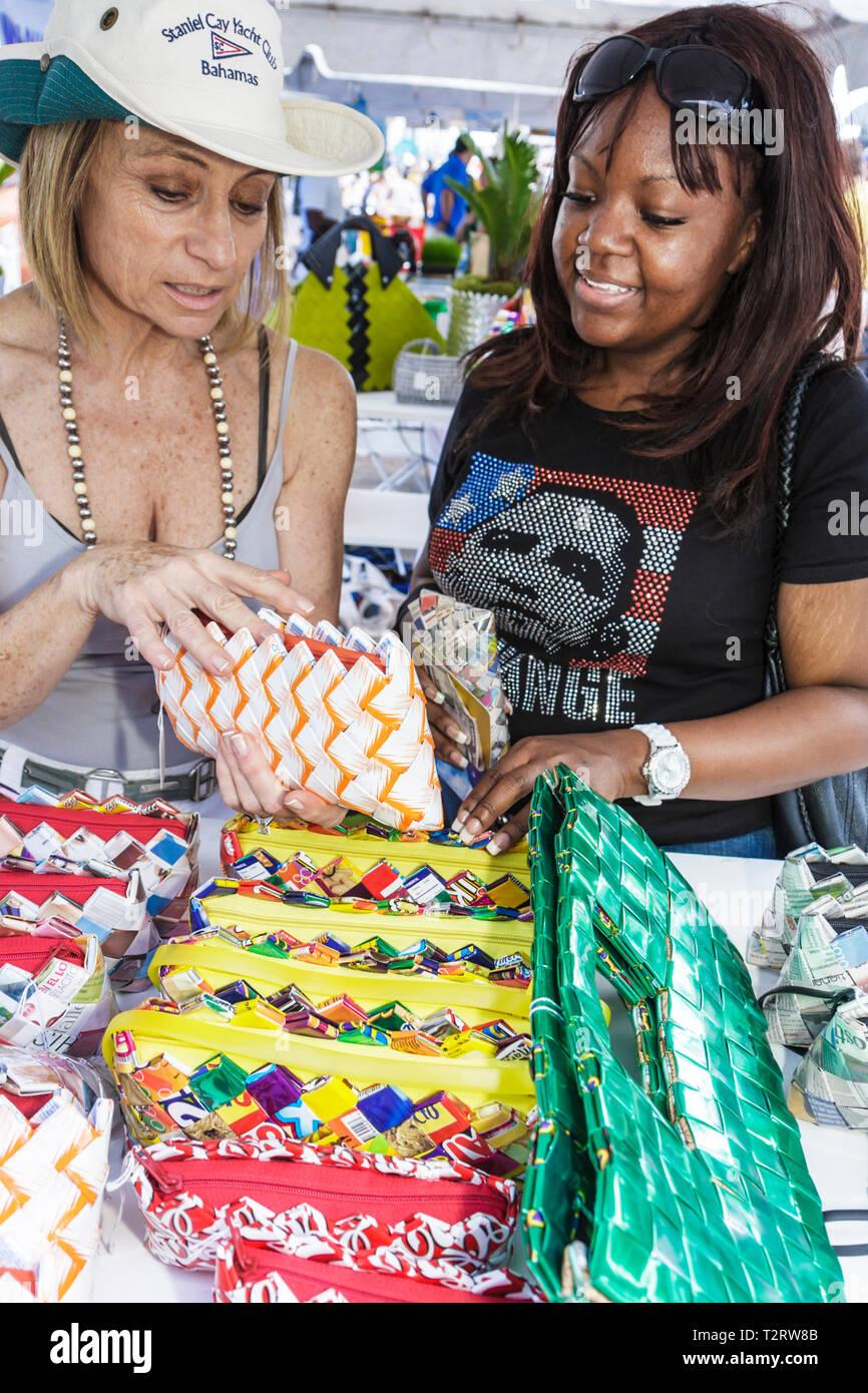 Miami Florida Bayfront Park Miami Goin' Green eco-friendly Earth Day celebration green event recycle recycling handbag purse can Stock Photo