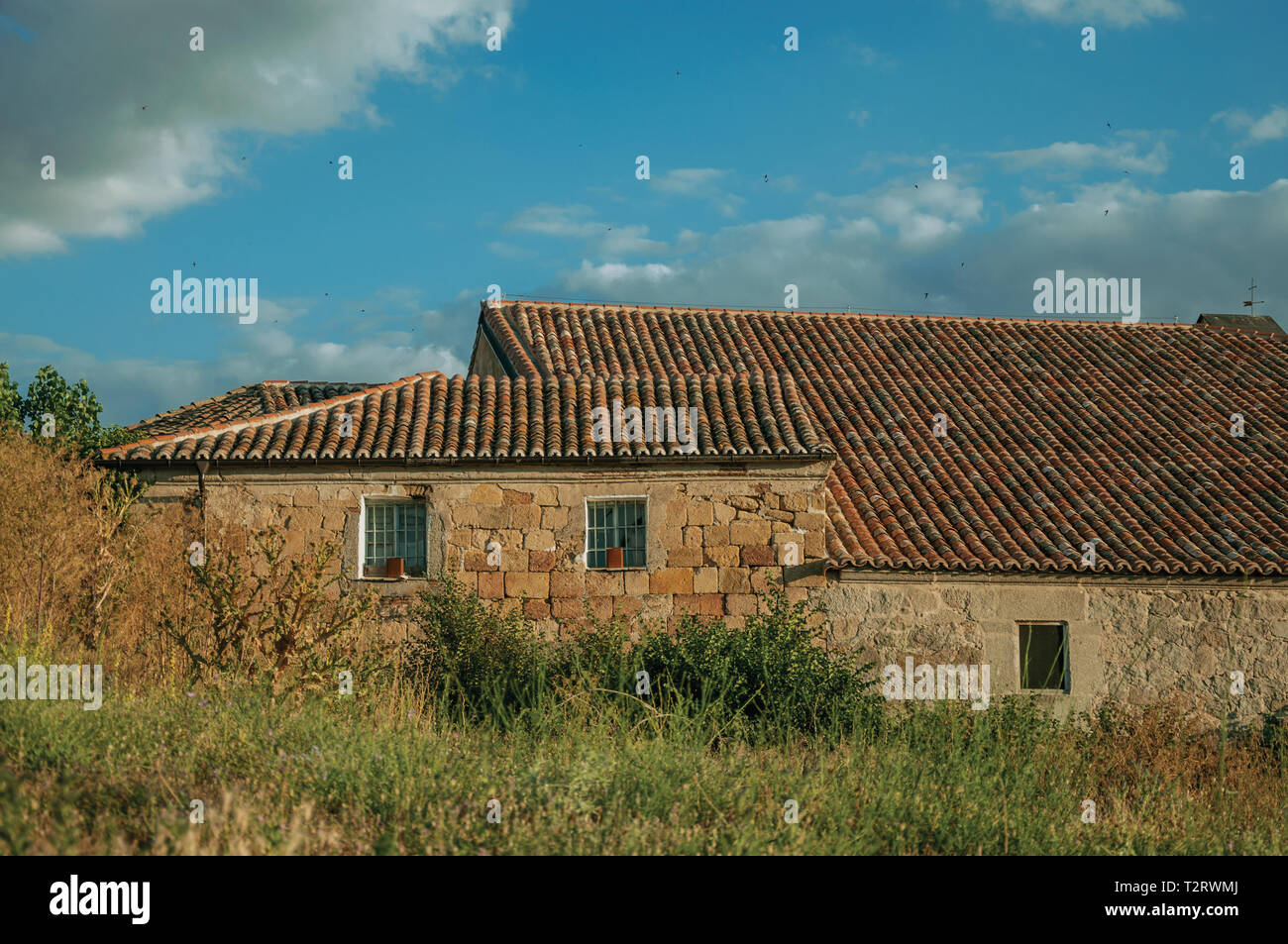 Stone Old House In Hilly Landscape With Green Undergrowth On Sunset At Avila With An Imposing Wall Around The Gothic City Center In Spain Stock Photo Alamy