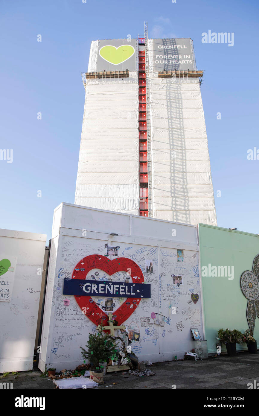 Tributes at the bottom of Grenfell Tower pictured in December 2018. - Stock Image