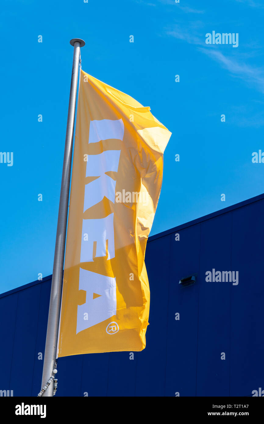 Coruna, Spain; april 01 2019: IKEA flag waving on flagpole on sunny day - Stock Image